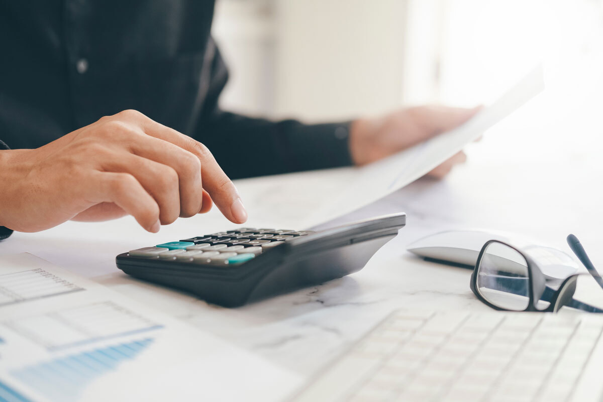 Man with a calculator doing accountancy work