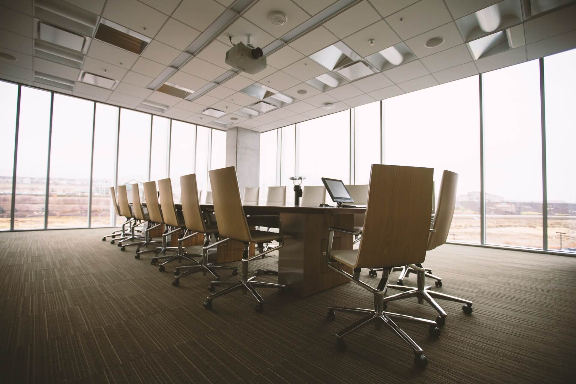 Empty Boardroom with 16 seats round a rectangular table