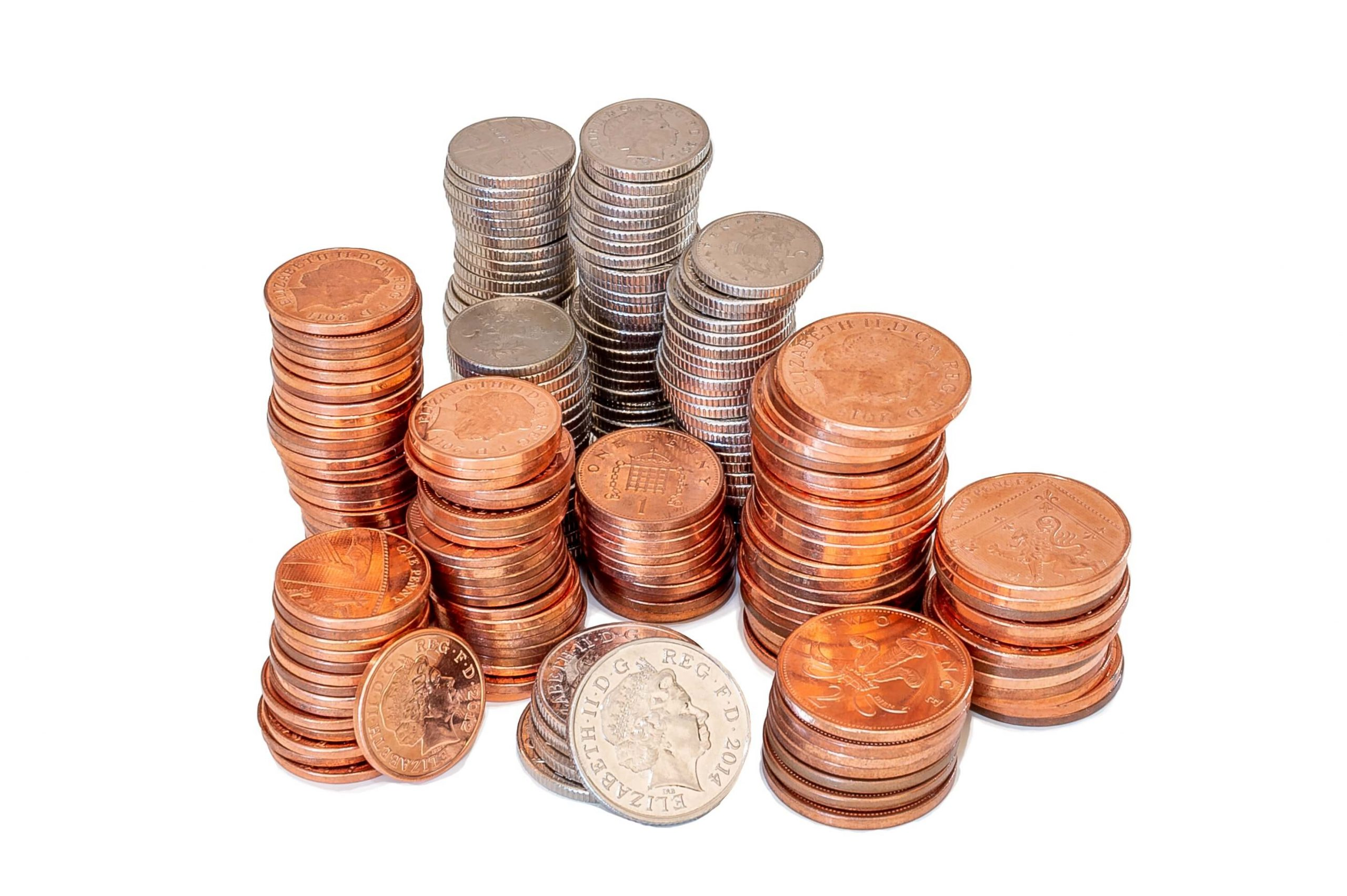 piles of coins on a white background